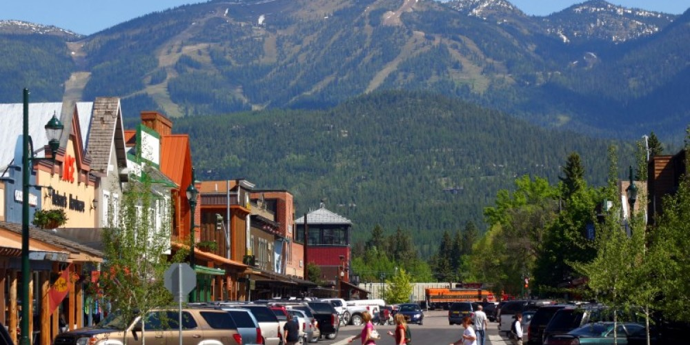 The peak of Big Mountain, home to Whitefish Mountain Resort, provides a scenic backdrop for downtown Whitefish. – Brian Schott