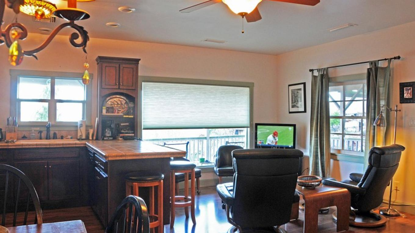 Comfortable seating, full kitchen and a big picture window at The Kelly House.... – Donna Chesler