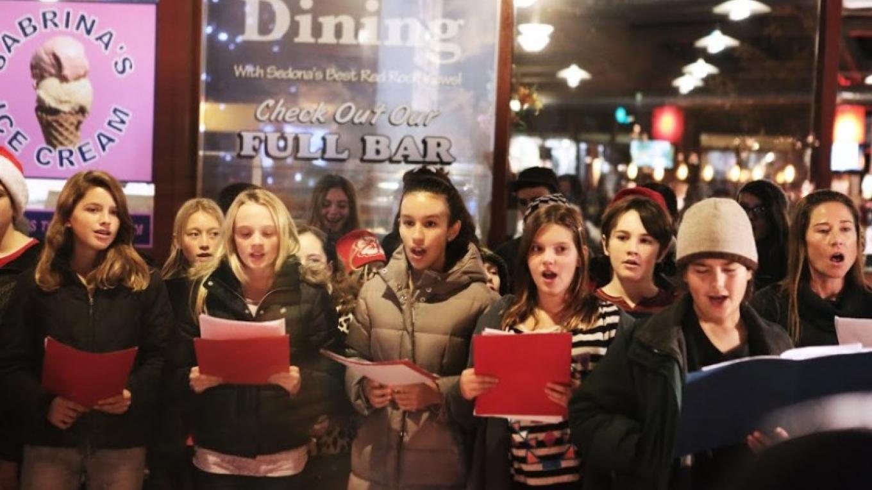 Desert Star Middle School Students caroling while Santa visits continue – Sedona Main Street Program