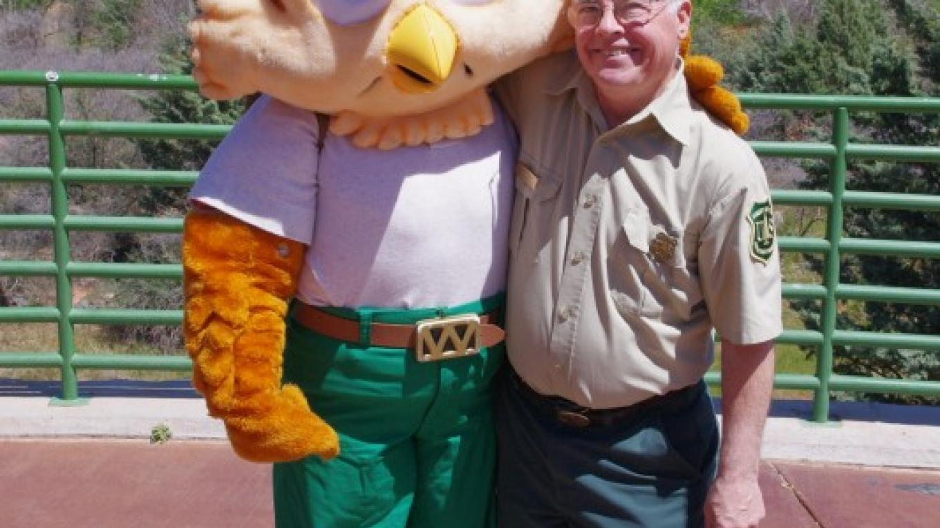"Woodsey Owl and his Ranger friend stop by the visitor center every once in a while to remind us to ""Lend a hand and care fore the land"". – Nina Hubbard"