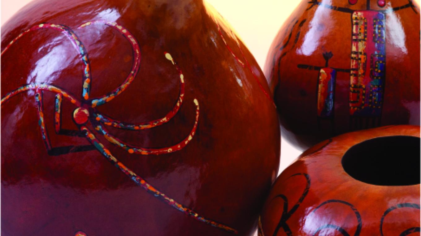 Gourds are a fruit of the Arizona desert. These pieces are cleaned, sealed, and hand-decorated with petroglyphic and desert images by Barry and Regina Crisman, Phoenix artists. – Zonies Galleria