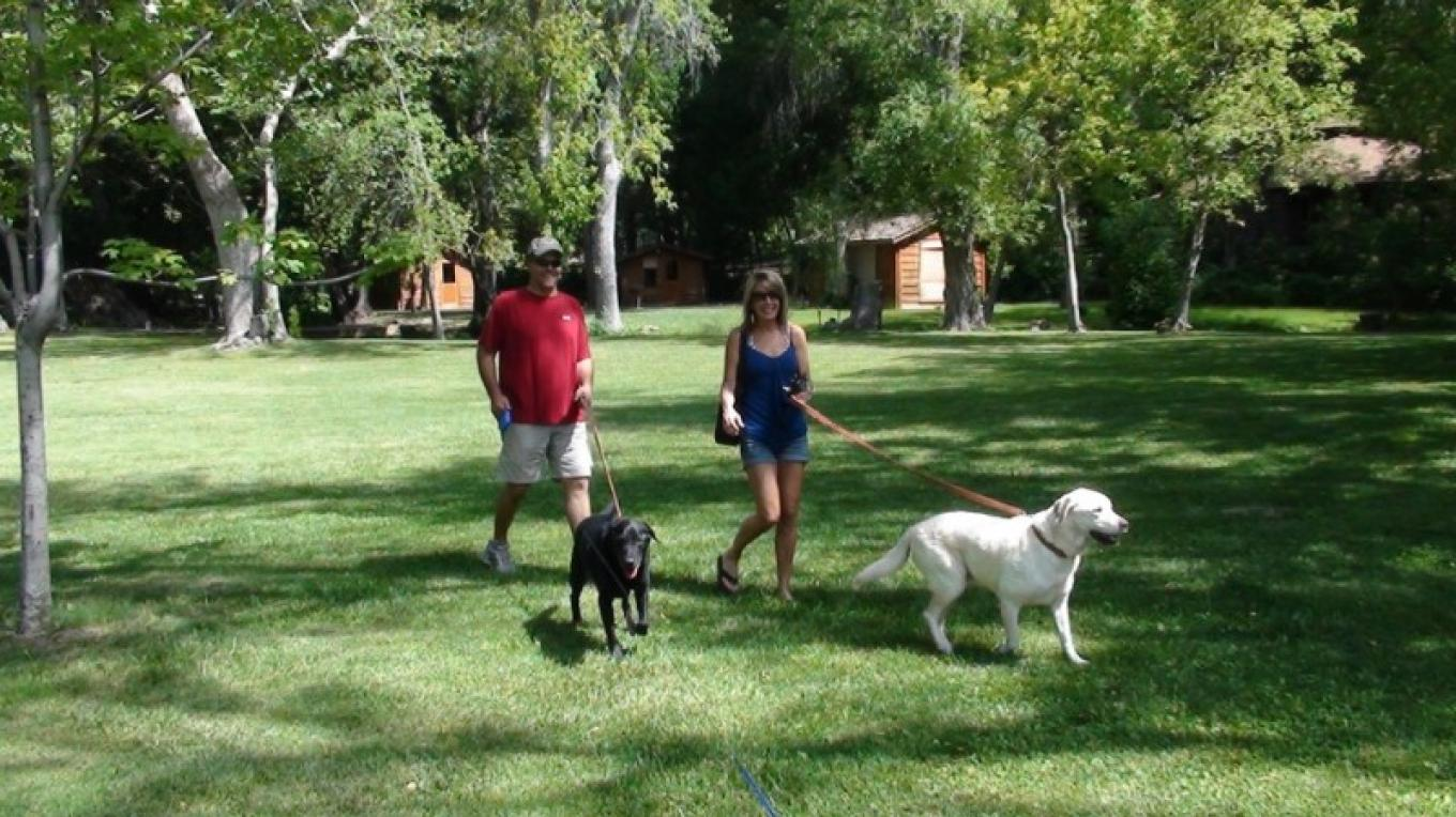 Clients enjoying their time in Sedona on their tour with their dogs. – Jim Reich