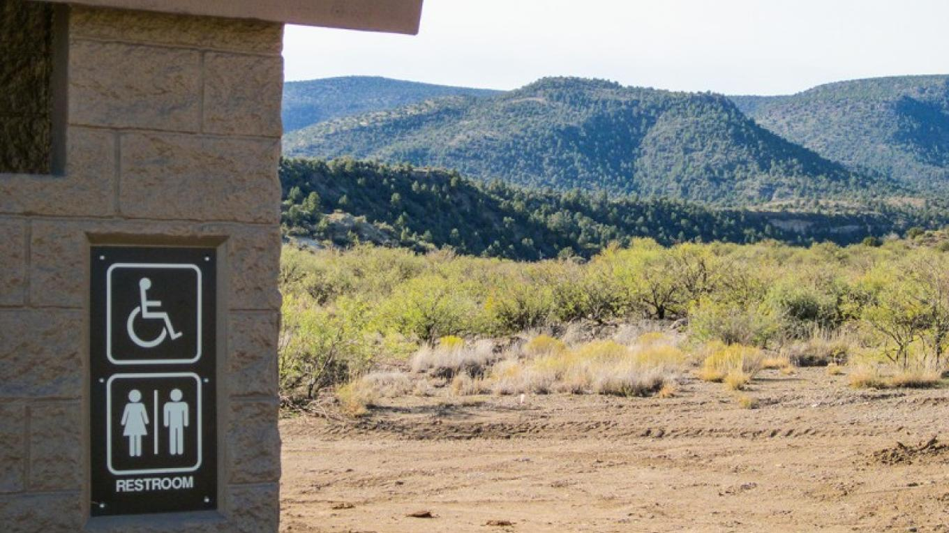 Foothills view from accessible restroom at Copper Canyon Trailhead. – USDA Forest Service