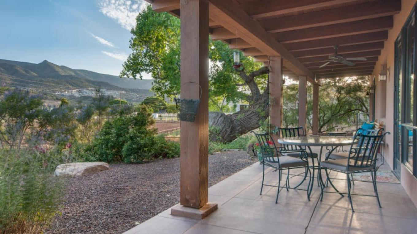 55' elevated covered patio looking to the mountains and pasture land – Ian Whitehead