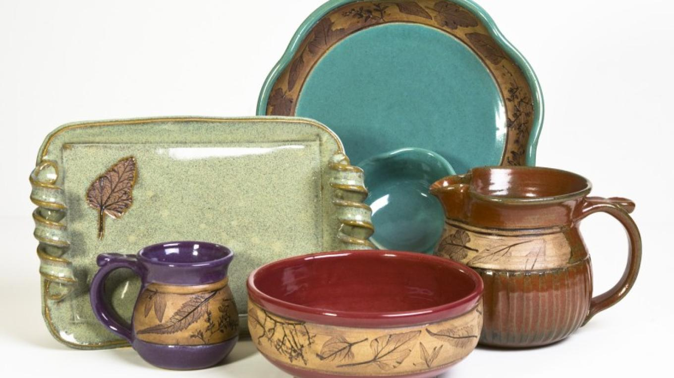 Beautiful and functional is the dinnerware created by Kathleen Wallace Greer of Tucson. Hand-formed of clay and imprinted with desert flora, the bright pottery is eye-candy. – Doug Von Gausig