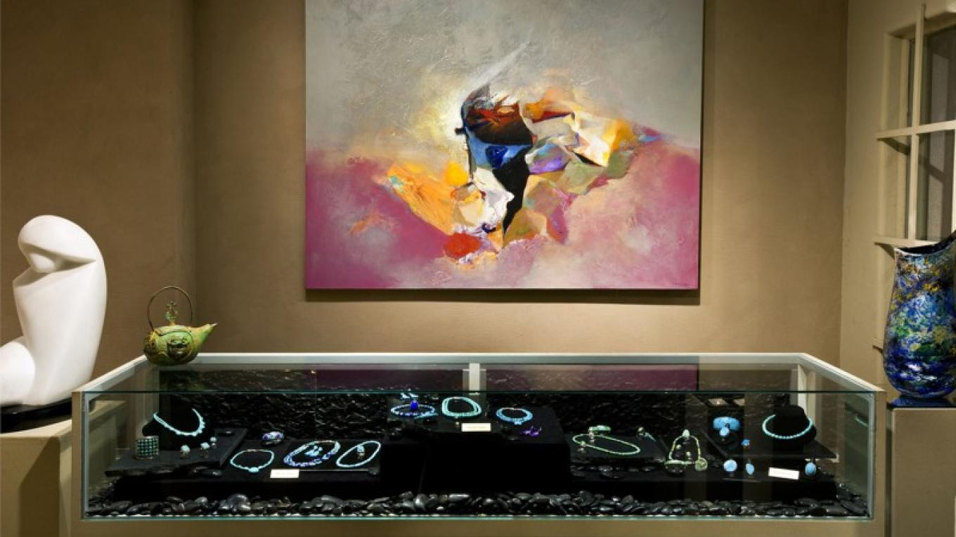 Acclaimed Navajo artist David Johns has shown his abstract paintings at Lanning Gallery for close to two decades. Local Master Jeweler Michael Grant is one of three exquisite jewelers represented. – courtesy Lanning Gallery or Michael Thompson