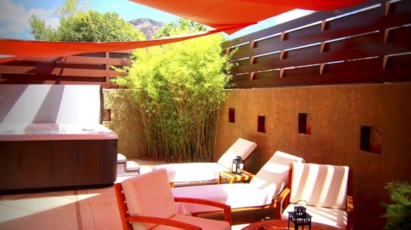 Enchanting courtyard area when you can enjoy healthy snacks of fruits and waters, and soak in a healing hot tub. – Paul Reilly for Google