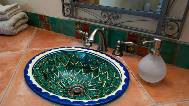 Bathroom sink (Mexican Talavera). – Nina Hubbard