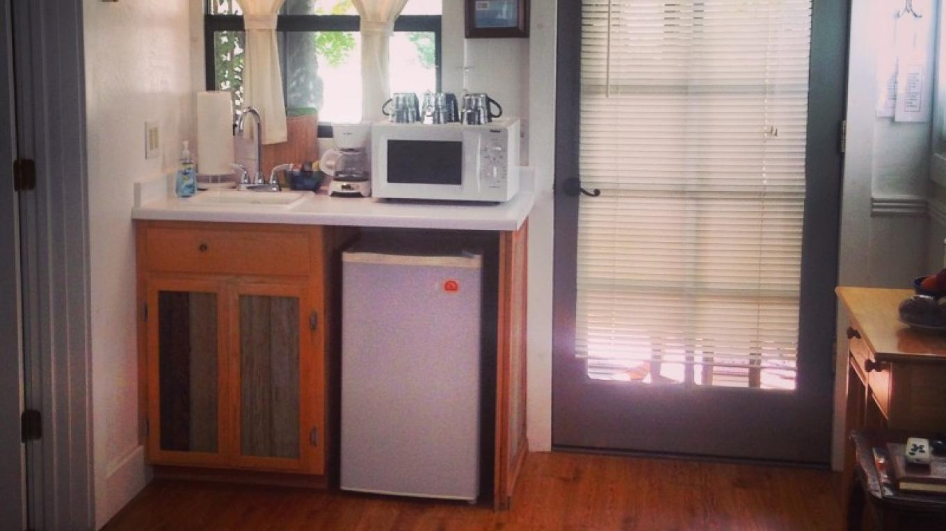 The kitchenette provides all that's needed for adventurers on the go or those looking to unwind on the front porch. From a cutting board to a corkscrew, you'll feel right at home. – M. Murphy
