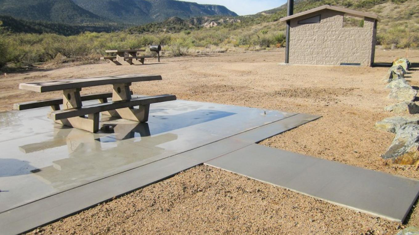 During the construction phase; this picnic table is now shaded by a ramada. – USDA Forest Service