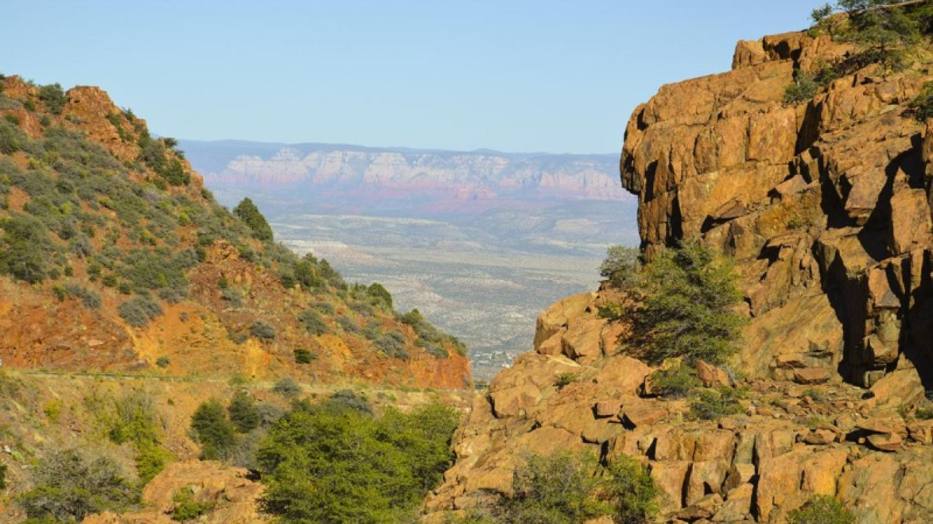 Peek-a-boo red rock view from Mingus Mountain Scenic Route, Hwy 89-A. – USDA Forest Service