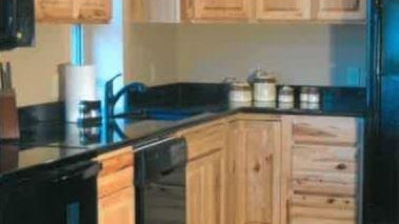Kitchen has all the essential appliances including a coffee bar
