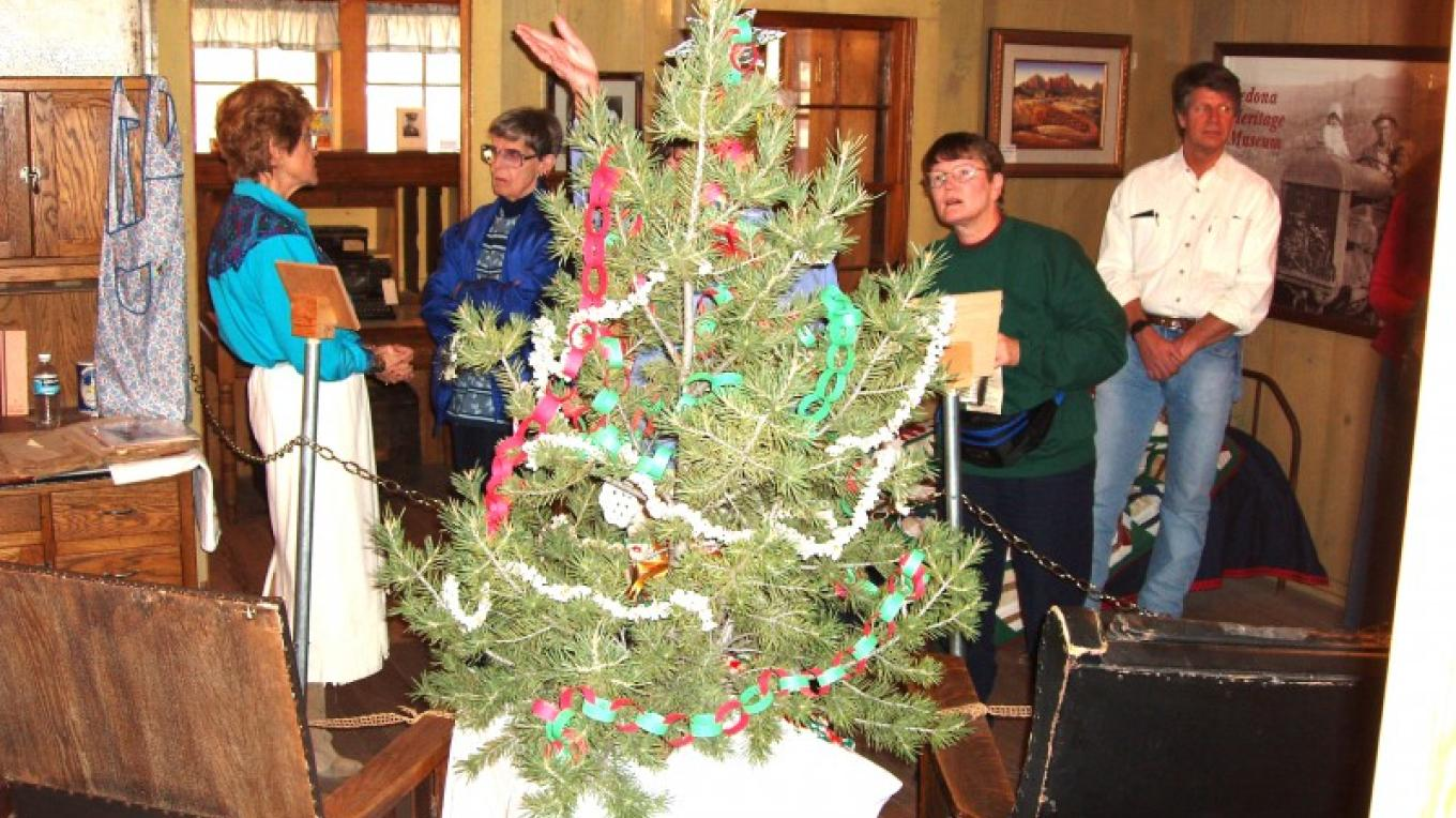 Museum volunteers welcome guests with old-time decorations and warmth.