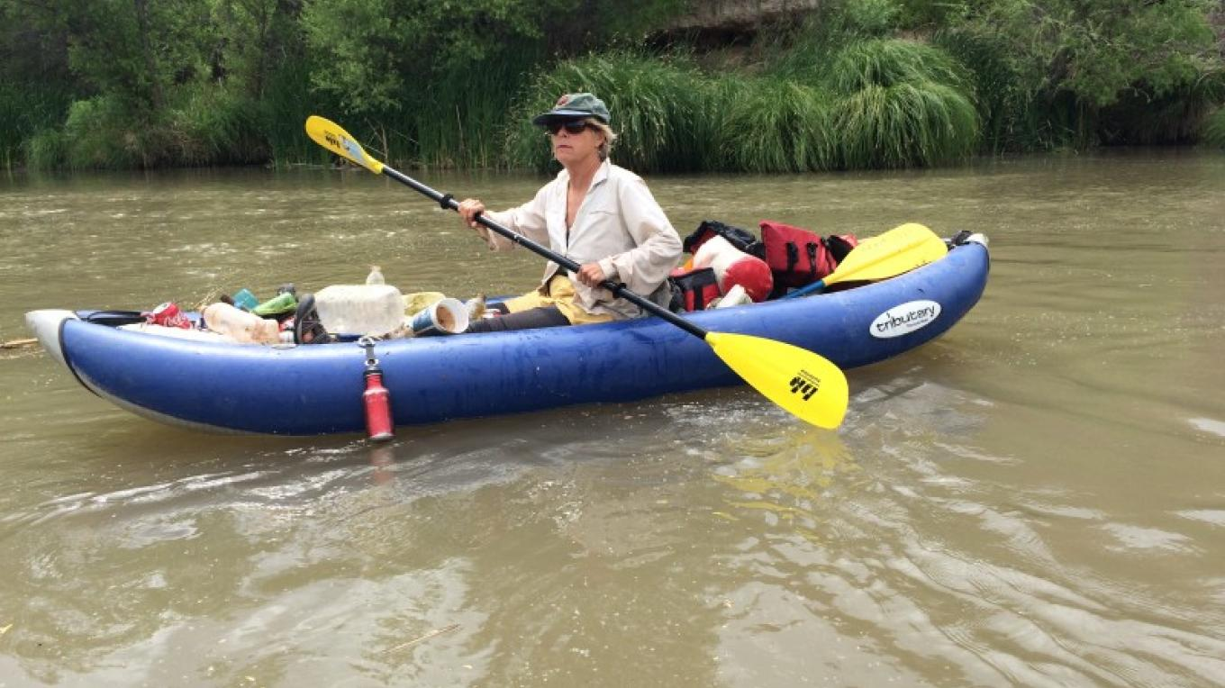 FVRG Board Member Marsha Foutz kayaking on the Verde and picking up a bit of trash along the way. – Laura Jones