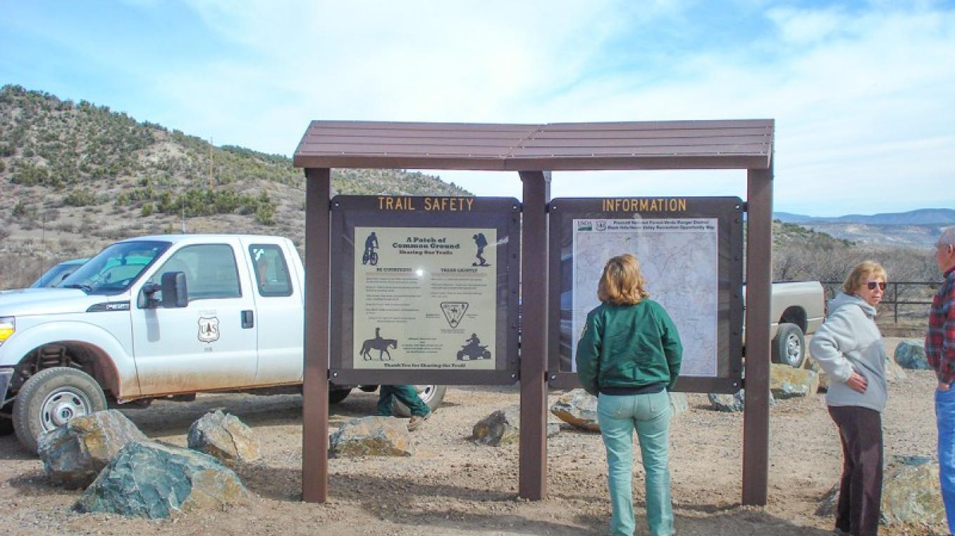 Information kiosk includes a large map with roads and trails nt the area, and explains trail etiquette for successful sharing of multiple-use trails. – USDA Forest Service