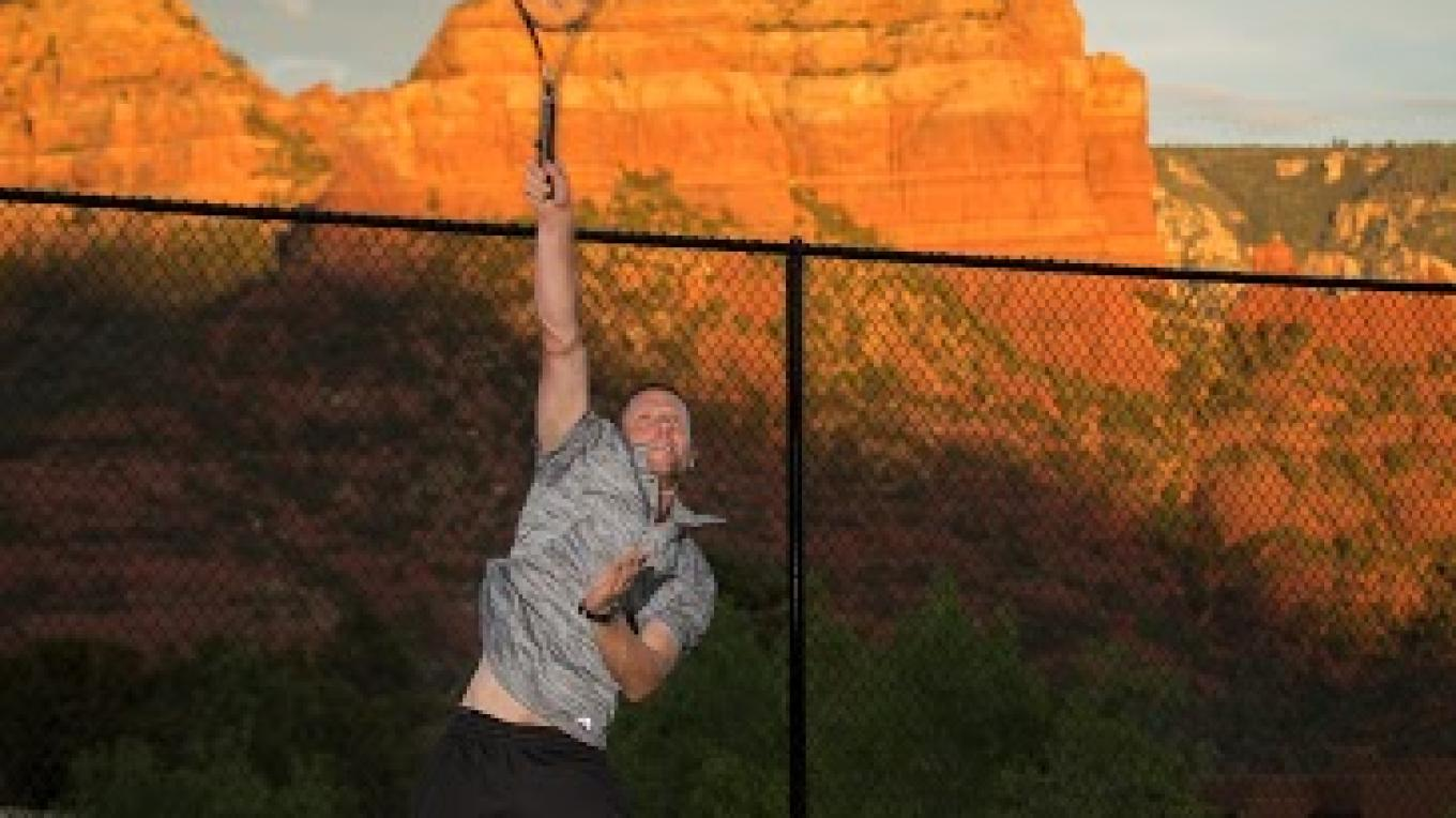Player hitting a serve with the beautiful geological rock formations of Sedona in the backgroud. Great exercise with incredible beauty. – Matt Valley