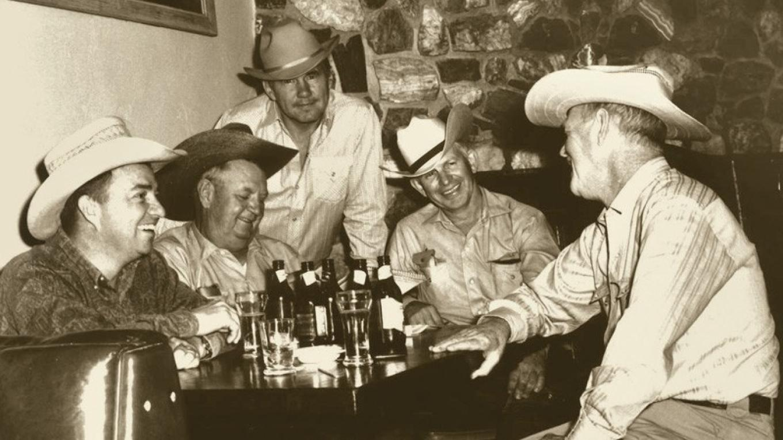 Artists Joe Beeler, Charlie Dye, John Hampton, George Phippen and western writer Robert MacLeod gather at the Oak Creek Tavern to found the Cowboy Artists of America, June 1965. – Elizabeth Rigby, Courtesy Sedona Heritage Museum