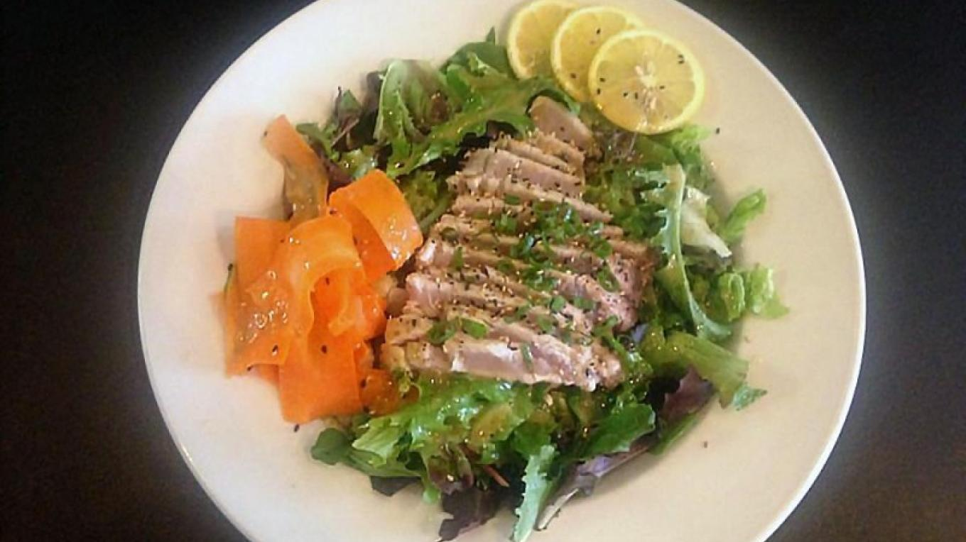 Seared tuna over spring mix – Boat House Bar and Grill