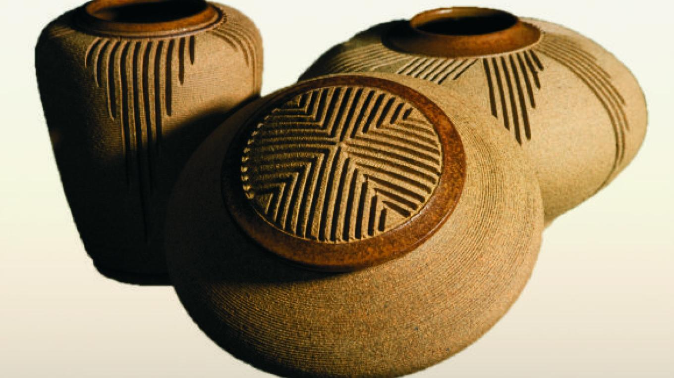 The collectible carved stoneware vessels by one of the owners, Stephen Scagnelli. Each piece is wheel-thrown, hand-glazed and carved with precision. – Doug Von Gausig