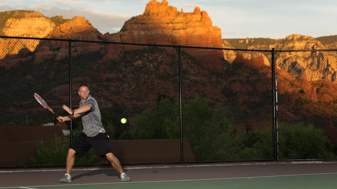 Player hitting a forehand with the beautiful geological rock formations of Sedona in the backgroud. Enjoying the surroundings while getting better at tennis. – Matt Valley