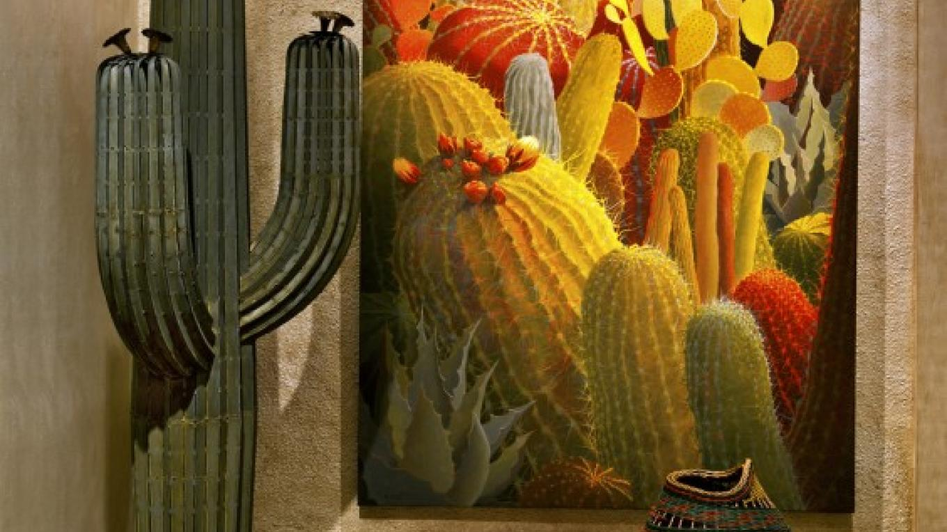 Steel cacti are offered in a variety of styles and sizes. Another fine cactus painting by Sharon Weiser. – courtesy Turquoise Tortoise Gallery