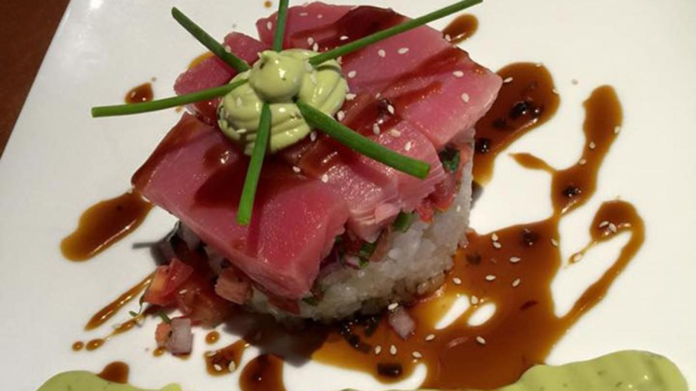 Ahi Tuna on a bed of sushi rice. – www.goldengoosegrill.com