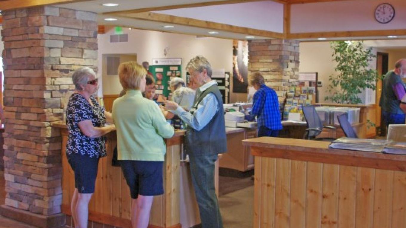 One of many friendly and knowledgeable volunteers at waiting to assist you at the visitor center. – Nina Hubbard