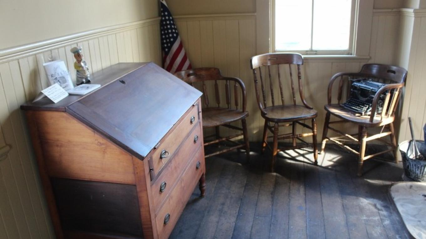 Town Hall and Lockup - desk and chairs. – Yvonne Gumaer
