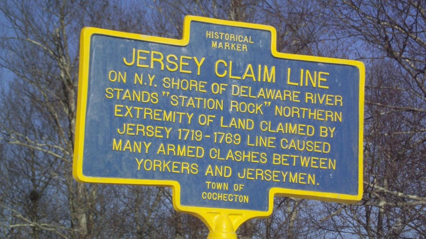 This historic marker along the Upper Delaware Scenic Byway in the Town of Cochecton interprets the New York-New Jersey Border Dispute. – Laurie Ramie