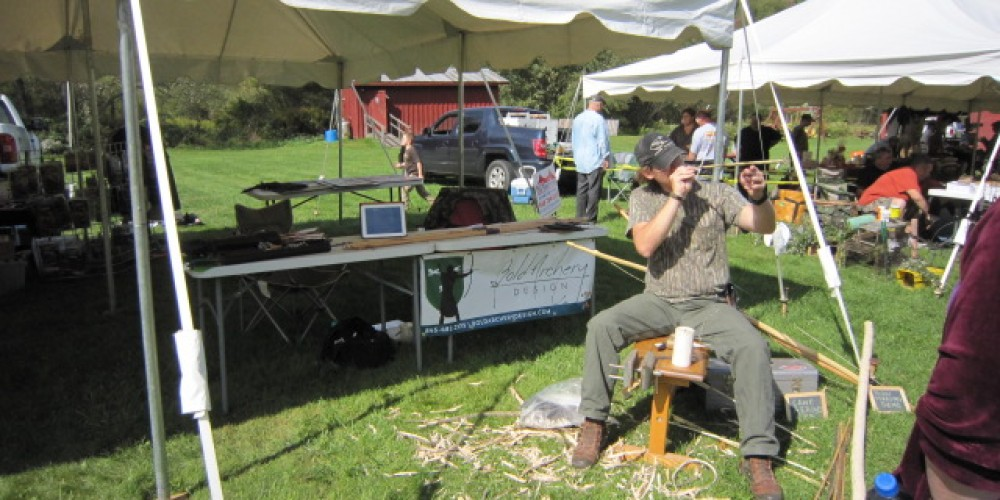 Venders booth at Sullivan County Long Beards Jake Event. Demonstrating how we make arrow shafts from cane. – Nuné Nazari