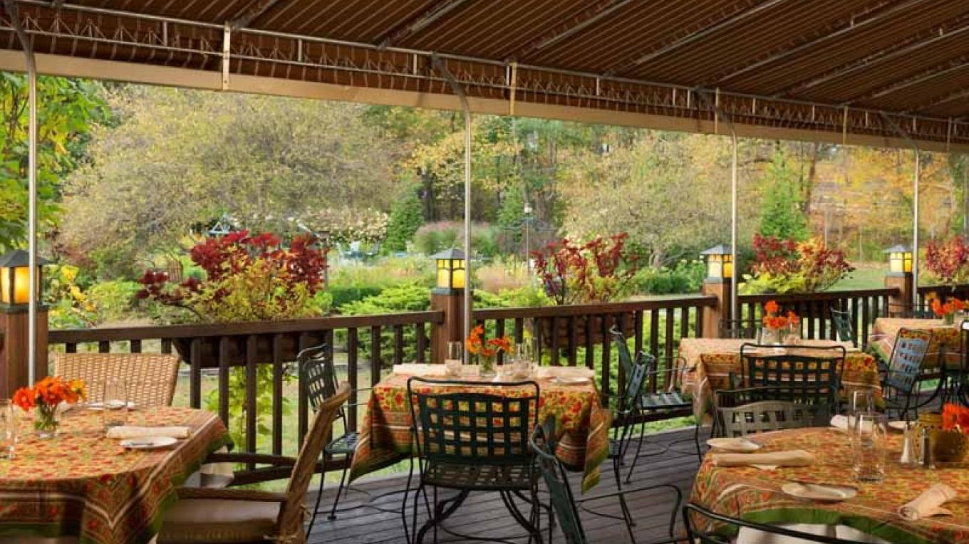 Savor a meal on our garden view terrace – Jumping Rocks