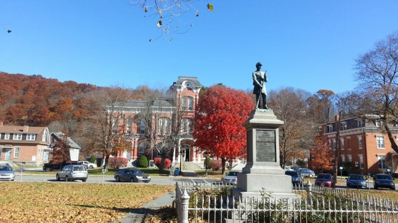 Central Park, Honesdale, with memorial statue, Wayne County Courthouse, and other historic buildings in the background. – Derek F. Williams