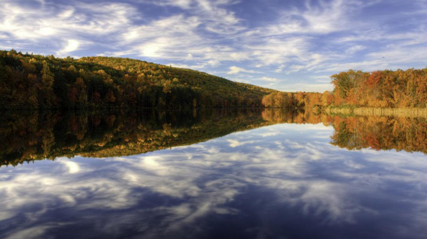 Hidden Lake surrounded by brilliant fall foliage. – National Park Service