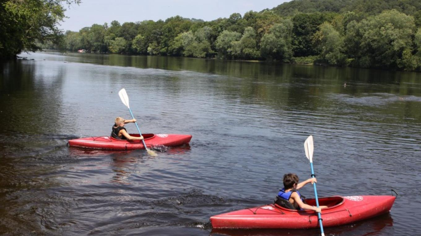 A friendly kayak race on the Delaware River held at Driftstone Campground. – Photograph by: Driftstone Campground