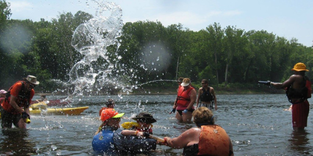 Sojourners take a break for some swimming and play on the Delaware River Sojourn. The Sojourn's number one rule is safety first - everyone must wear a life jacket at all times on, near, or in the water.