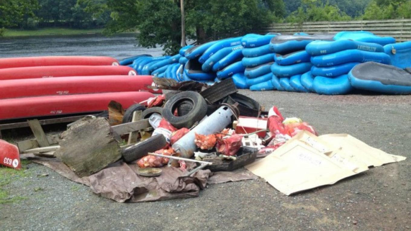 """SOME"" of the litter and debris collected by volunteers, campers and staff at the annual Kittatinny Canoes Delaware River Clean-Up. – Photograph by: Kittatinny Canoes, Inc"