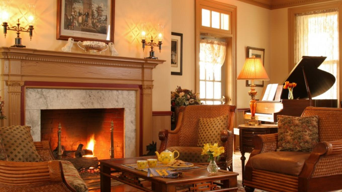 Stately parlor with gas fireplace – Jumping Rocks Photography