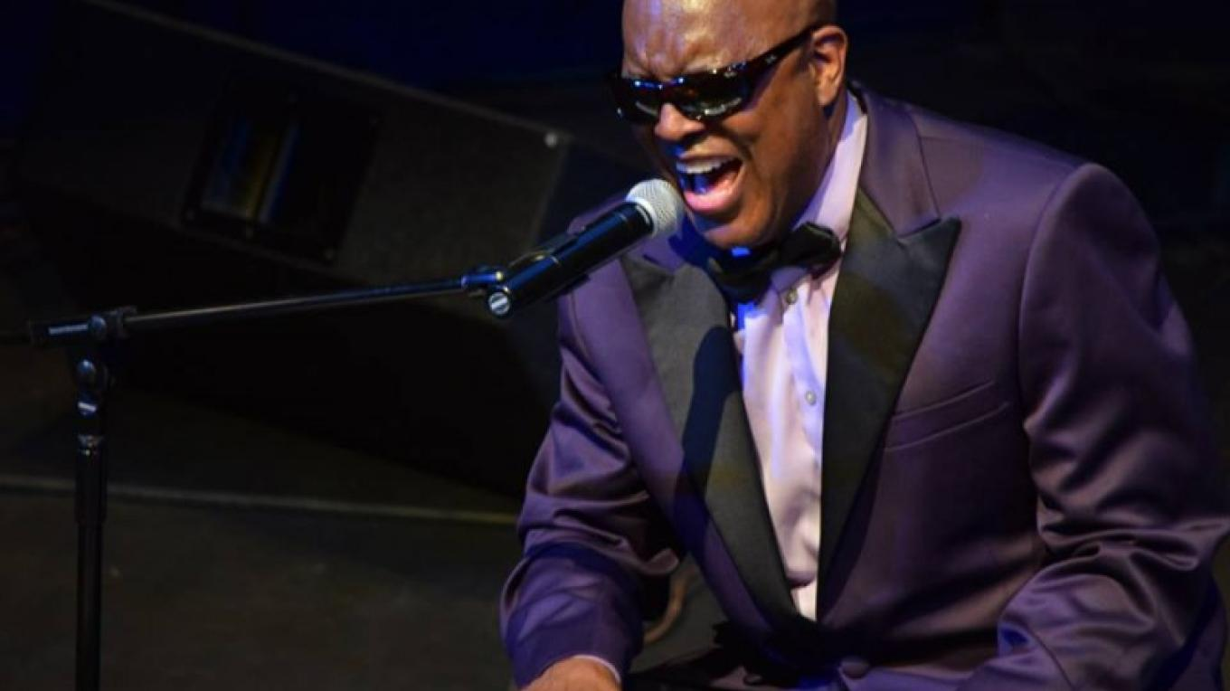 """Kenny Brawner croons as Ray Charles in his theatrical concert, """"Ray Charles on my Mind."""" – Chris Young"""