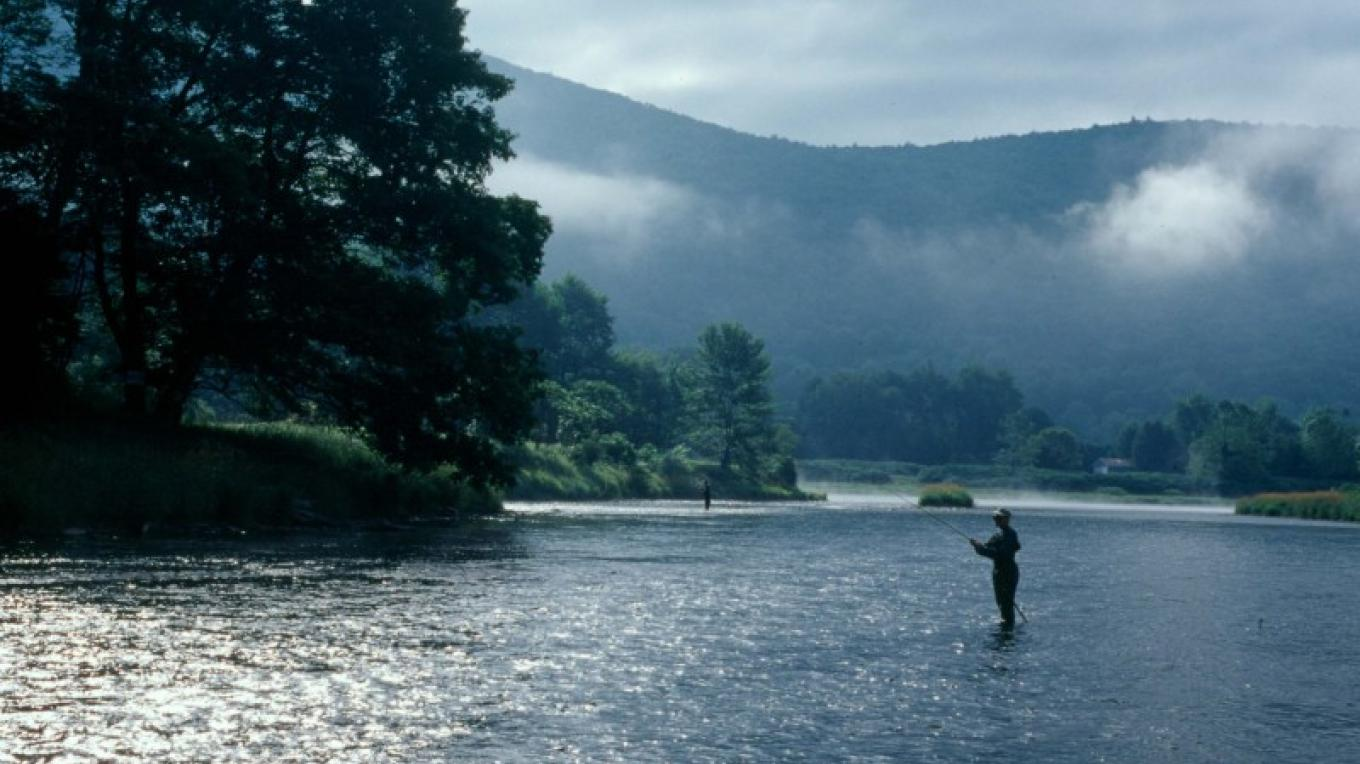 Partnering with others to conserve our Parks' natural resources. Pictured: A fisherman casts his line in the Upper Delaware River. – David B. Soete