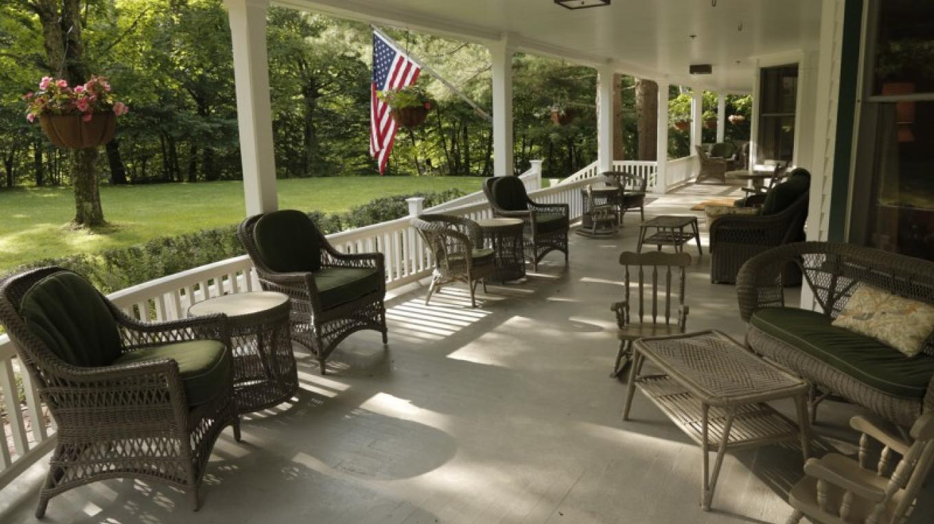 Relax on the wrap around porch – Walter Hodges