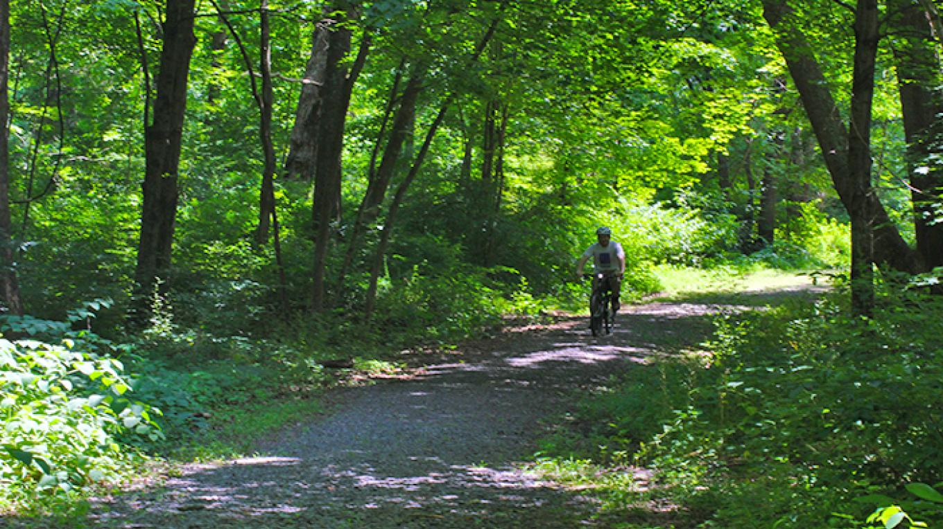 The McDade Trail is a popular spot for biking. The crushed stone trail varies in intensity. – National Park Service