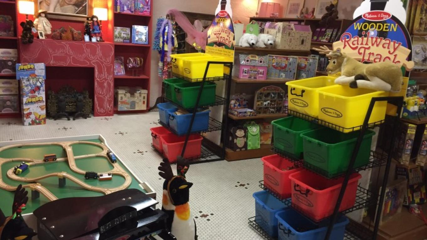 View of right side of Orion's Toyworks showing the train play table and bins containing train track and locomotive cars and engines. – Theresa Veltri