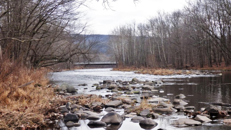 Neversink River...popular with fisherman – Photograph by: Lynn M. Burns