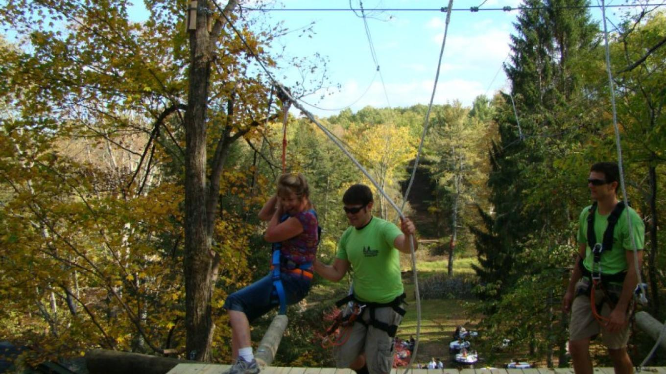 Walk to the top then zip down at Pocono Zip Racer. – David Coulter