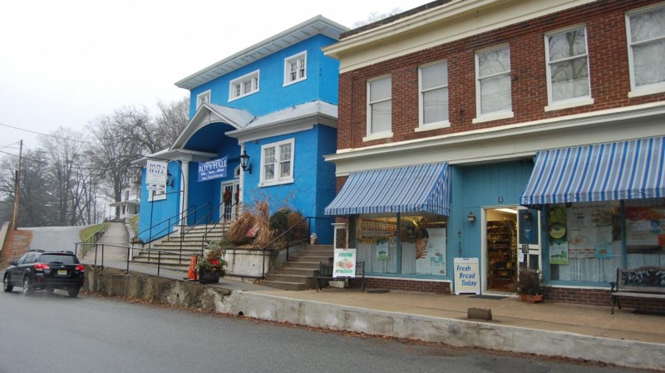 Main Street, Blairstown at west end - This view is in an opening scene in the movie. Annie can be seen walking down the hill and past these buildings. Roy's Hall (blue) was painted red at the time of the filming. – Christine Beegle