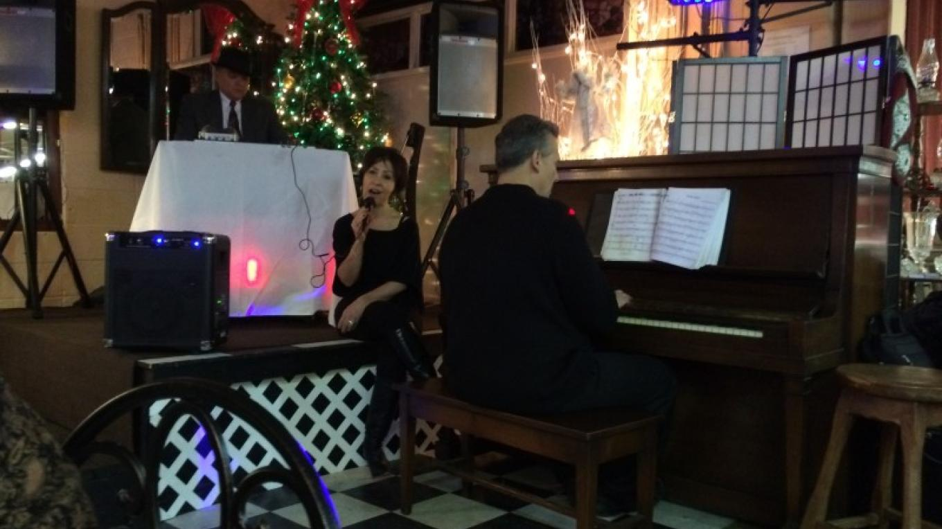 Entertainment during Frank Sinatra's 100th birthday celebration. – Photograph by: Gracie's Cafe