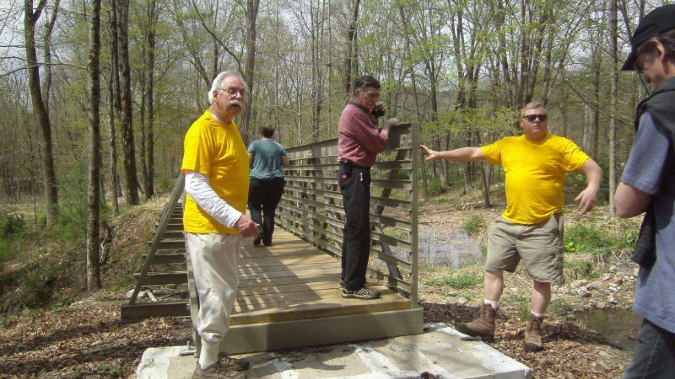 A portable bridge had to be built in Westbrookville, NY to accommodate hikers along the D&H Canal Path, all accomplished by volunteers through grants and donations. – Laurie Ramie