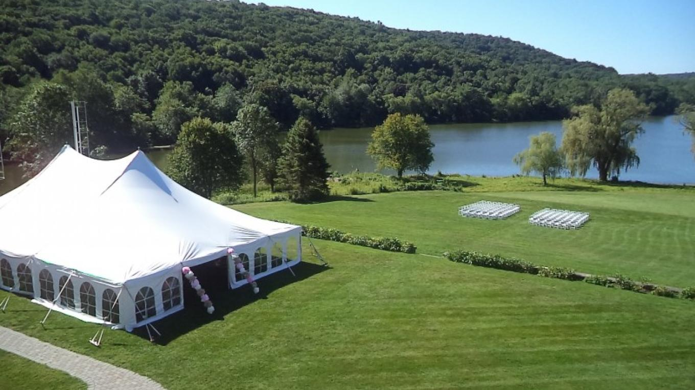 The back grand lawn of Rutherfurd Hall set up for a wedding – Laurie Rapisardi