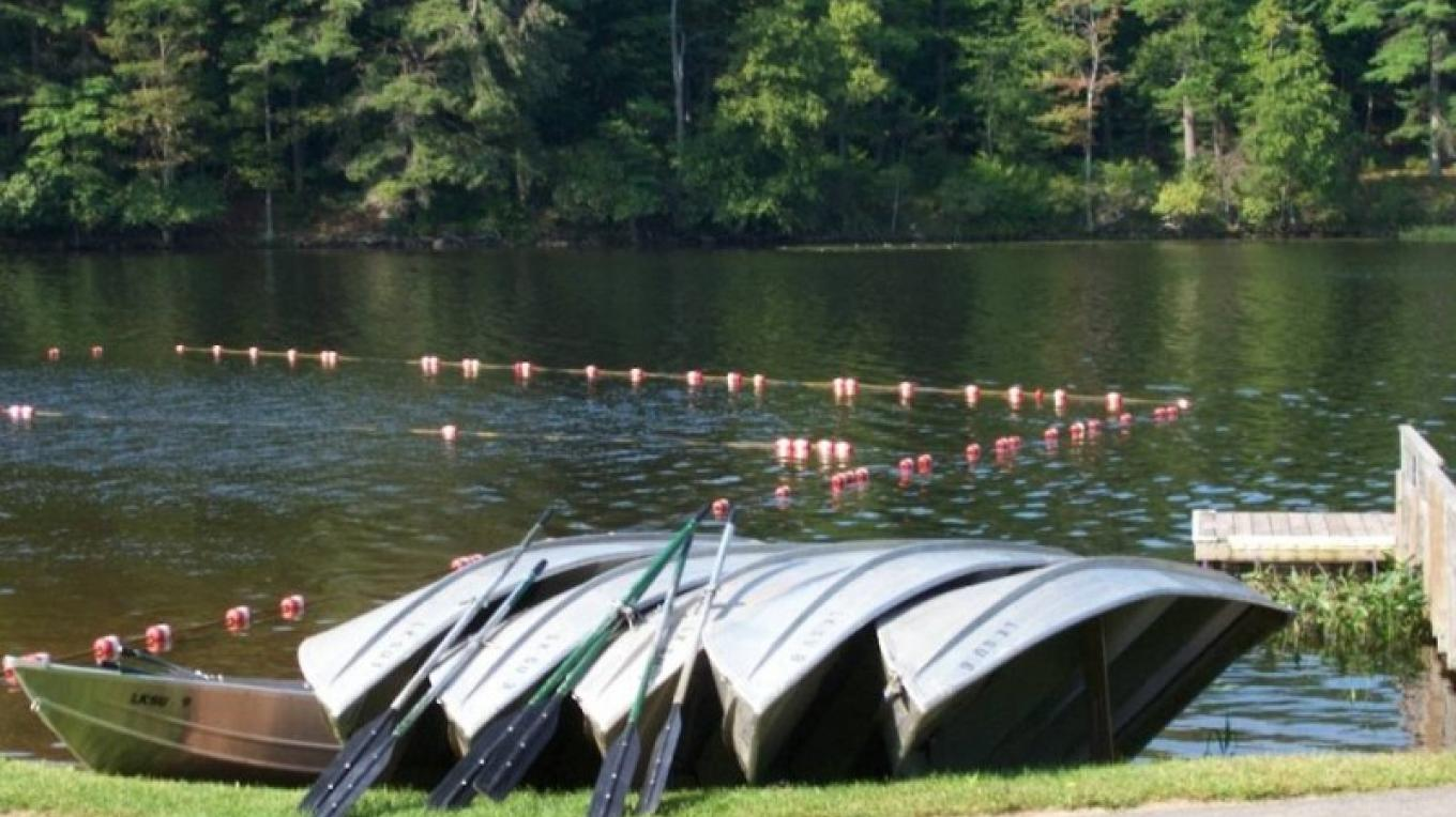 Rowboats ready for rental adjacent to swim area at Lake Superior. – Photo by: Sullivan County Parks.
