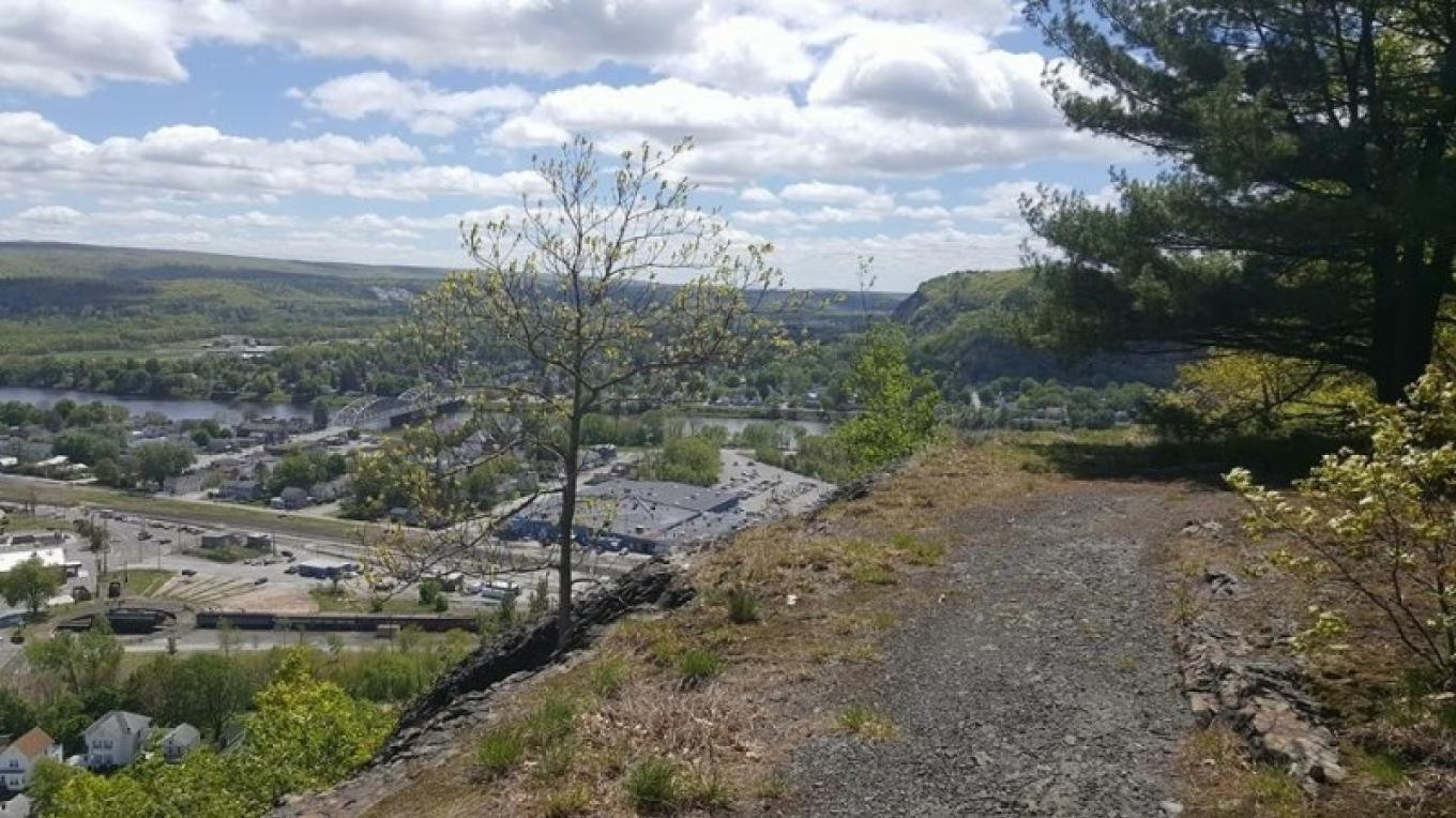 View of the Tri-state juncture from the turntable trail. Port Jervis, NY below, Pennsylvania to the right, New Jersey in the horizon. – Outdoor Club of Port Jervis